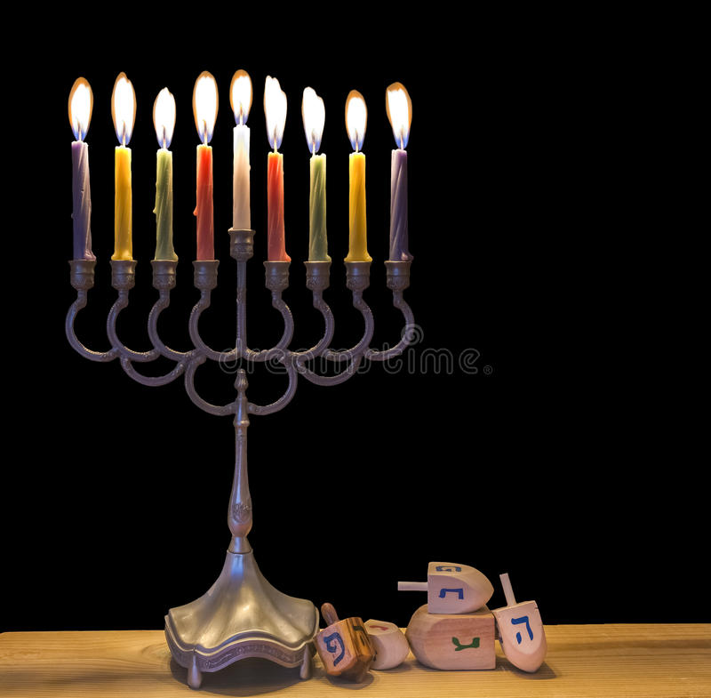 Menorah is traditional Jewish symbol for Hanukkah holiday. Image was at black background royalty free stock photography