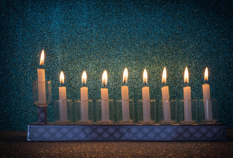 Menorah is traditional Jewish symbol for Hanukkah holiday. Image was taken using glitter materials stock images