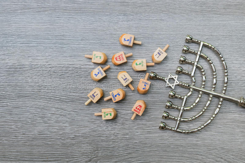 Menorah on wooden table. Hanukkah symbol. Menorah on wooden table. Hanukkah holiday symbol stock images