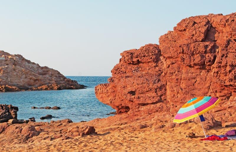 Menorca, Balearic Islands, Spain, Cala Pregonda, Mediterranean Sea, beach, martian, landscape, red, Mars, beach umbrella royalty free stock photography