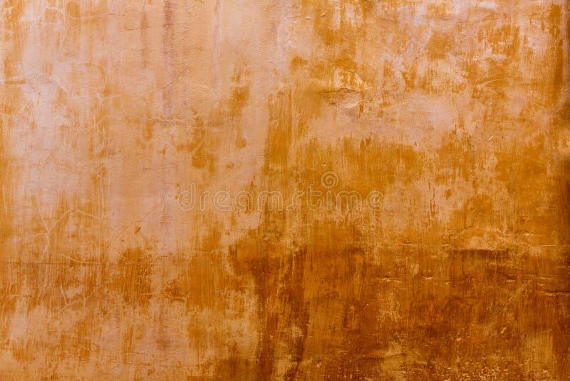 Menorca Ciutadella golden grunge ocher facade texture. At Balearic islands stock images