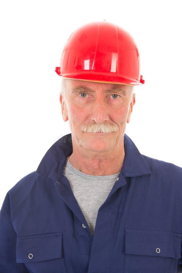 Mens in blauw globaal met rode helm royalty-vrije stock afbeeldingen