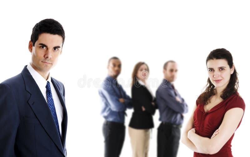 Mens in blauw met het team stock afbeeldingen