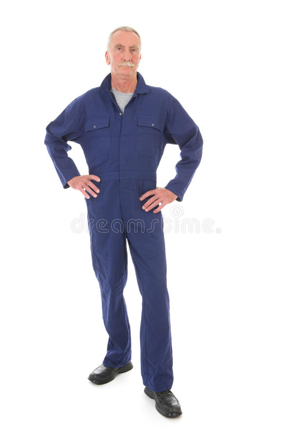 Mens in blauwe algemeen stock afbeelding