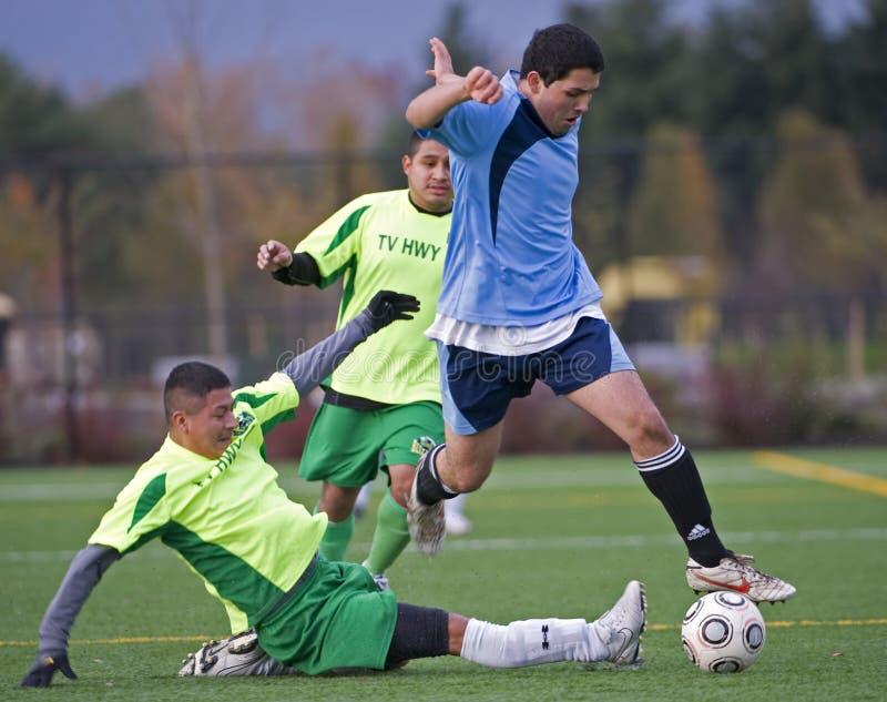 Mens club Soccer leap stock photo
