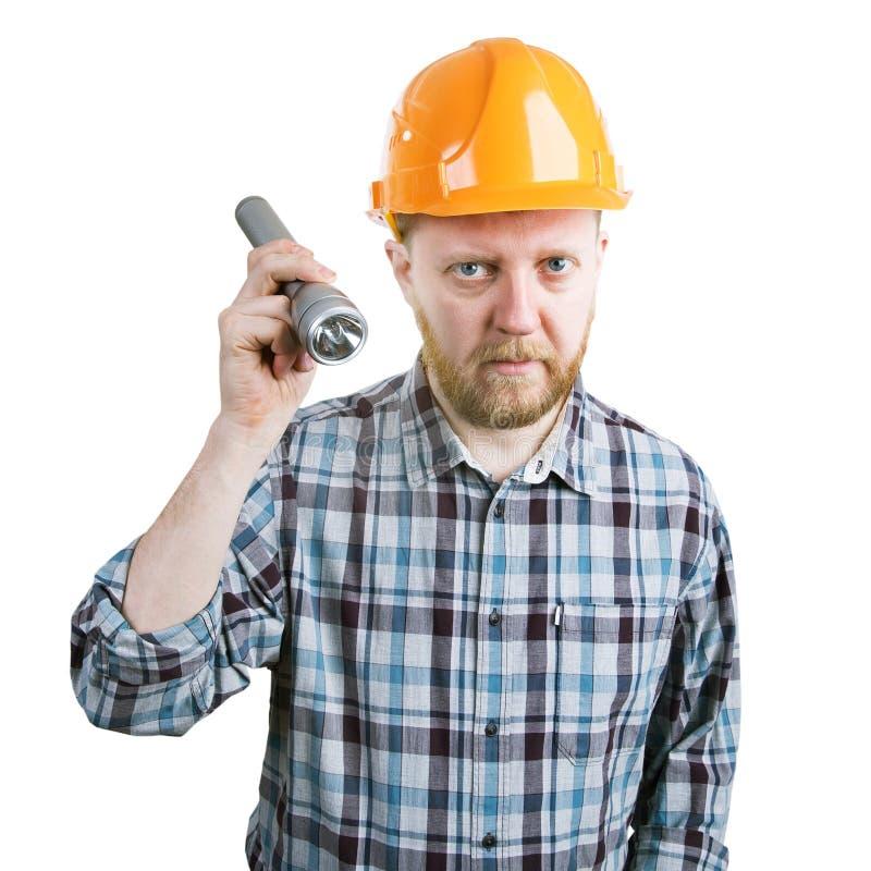 Mens in de helm met een flitslicht stock afbeelding