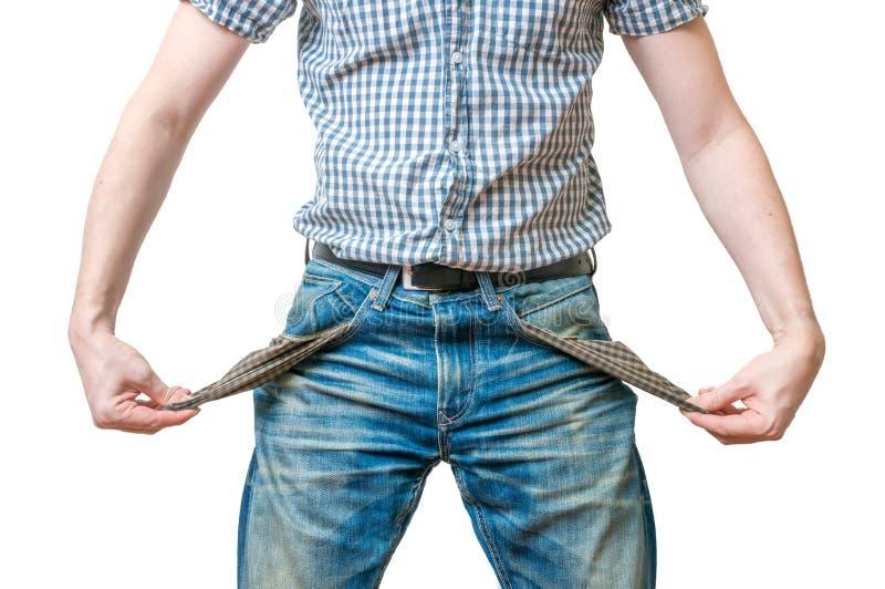 Mens - de schuldenaar toont lege zakken van zijn jeansans symbool van geen geld royalty-vrije stock foto's
