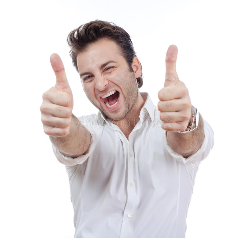 Mens die beide duimen tonen stock fotografie