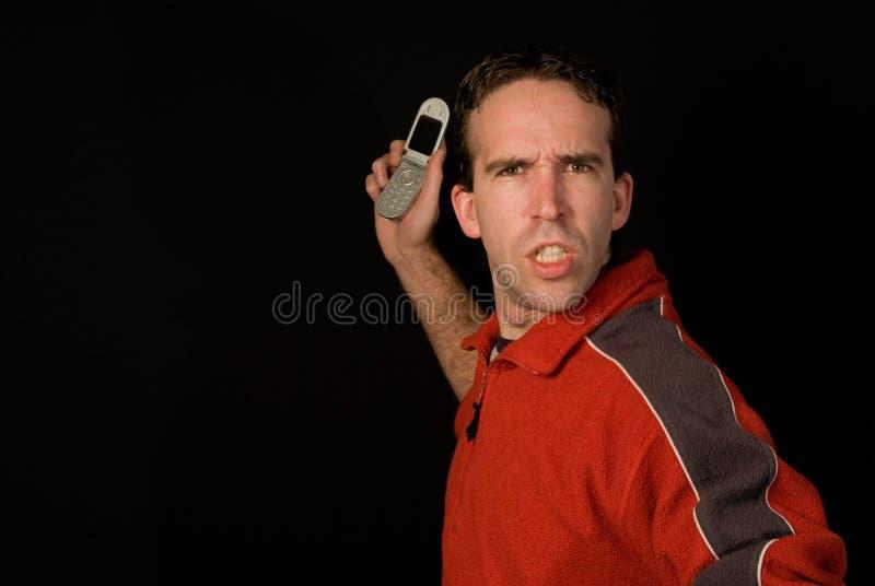 Mens die Cellphone werpt stock afbeeldingen