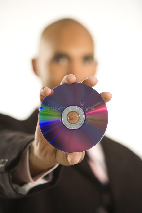Mens die compact disc houdt. royalty-vrije stock fotografie