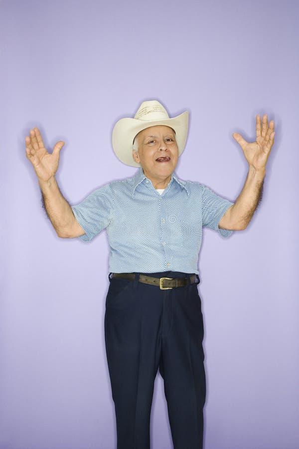 Mens die cowboyhoed draagt. stock fotografie