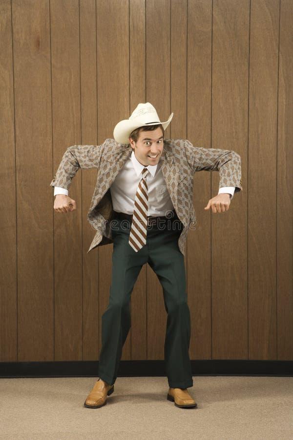 Mens die cowboyhoed het dansen draagt. stock afbeeldingen