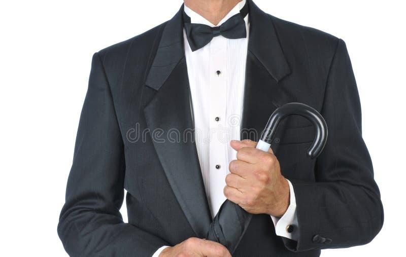 Mens die de Paraplu van de Holding van de Smoking draagt royalty-vrije stock foto