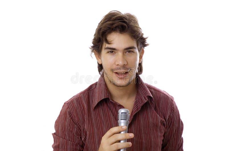 Mens die door microfoon spreekt royalty-vrije stock afbeelding