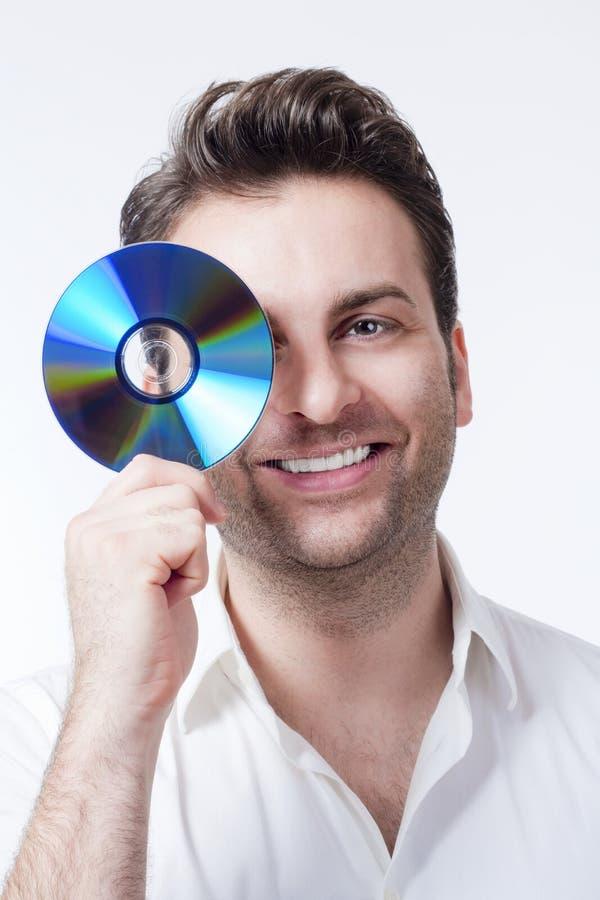 Mens die een CD houdt stock foto
