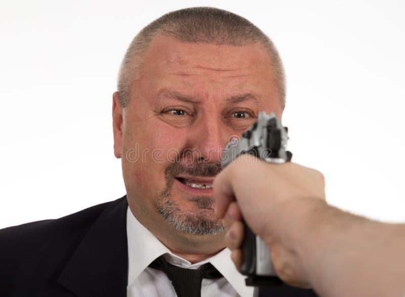 Mens die een Kanon op zakenman richten royalty-vrije stock foto