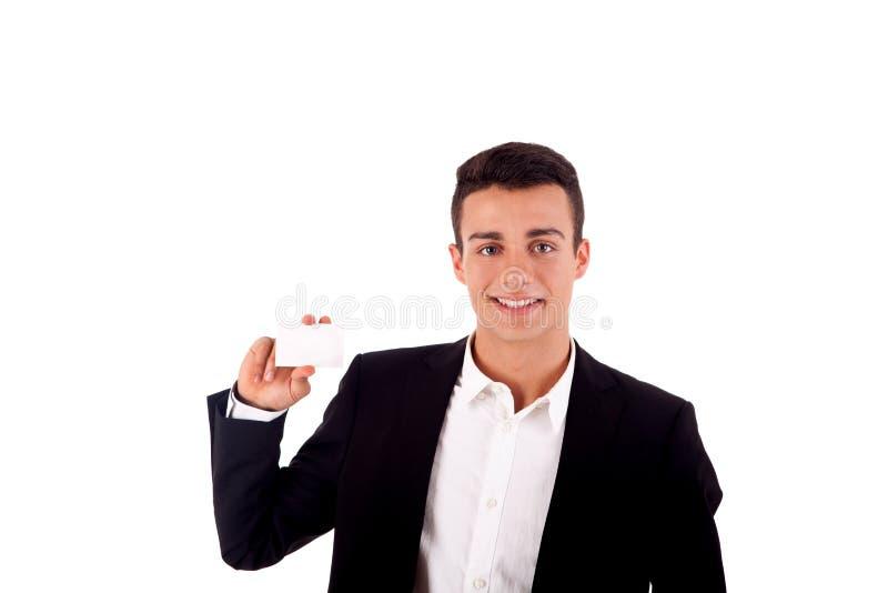 Mens die een leeg adreskaartje over wit teruggeven royalty-vrije stock afbeelding