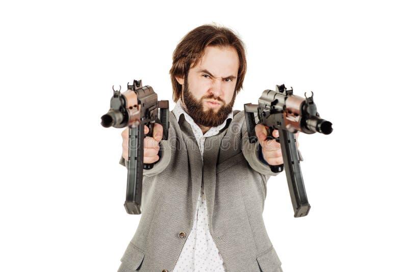 Mens die een machinegeweer houden die op witte achtergrond wordt geïsoleerd stock fotografie