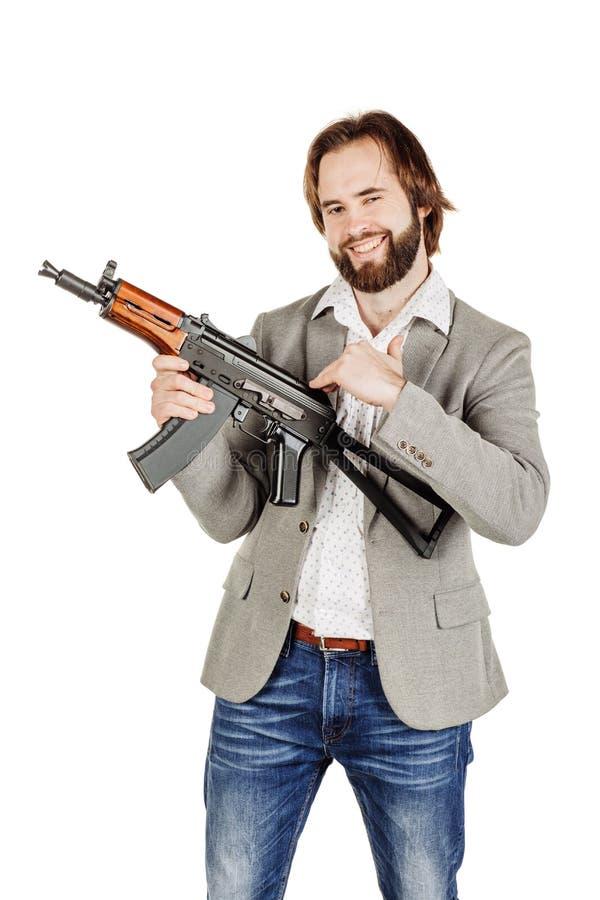 Mens die een machinegeweer houden die op witte achtergrond wordt geïsoleerd royalty-vrije stock foto's