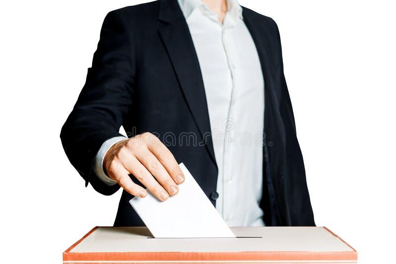 Mens die een Stemming zetten in een Stemmingsdoos op Witte Achtergrond Het Concept van de democratievrijheid royalty-vrije stock fotografie