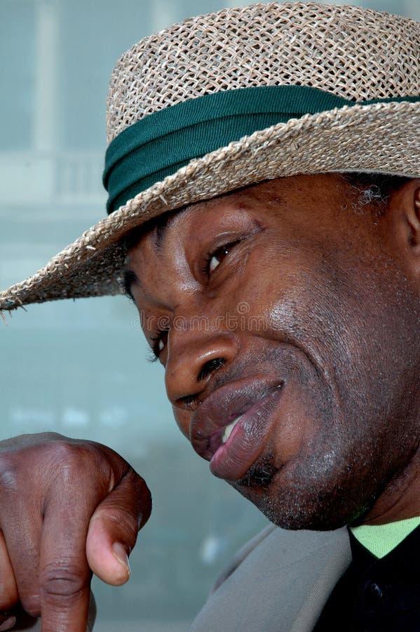 Download Mens Die Een Strohoed Draagt Stock Foto - Afbeelding bestaande uit afrikaans, stro: 286424