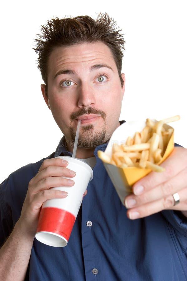 Mens die Frieten eet royalty-vrije stock foto's