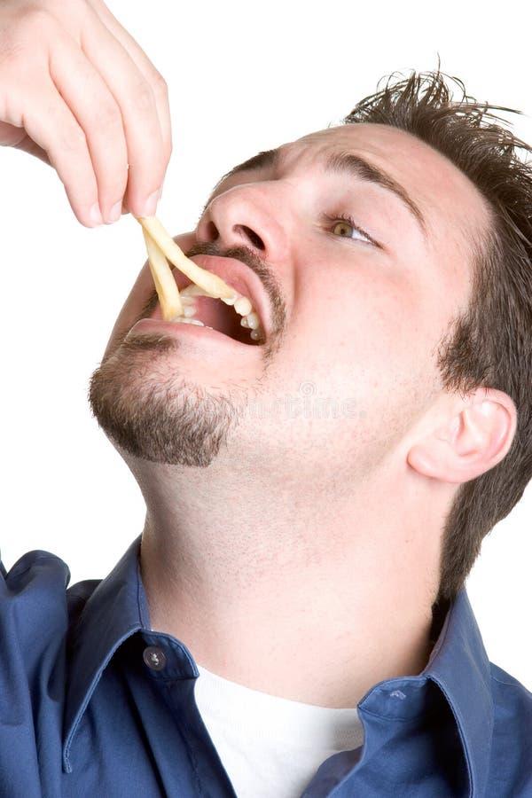 Mens die Frieten eet royalty-vrije stock afbeelding