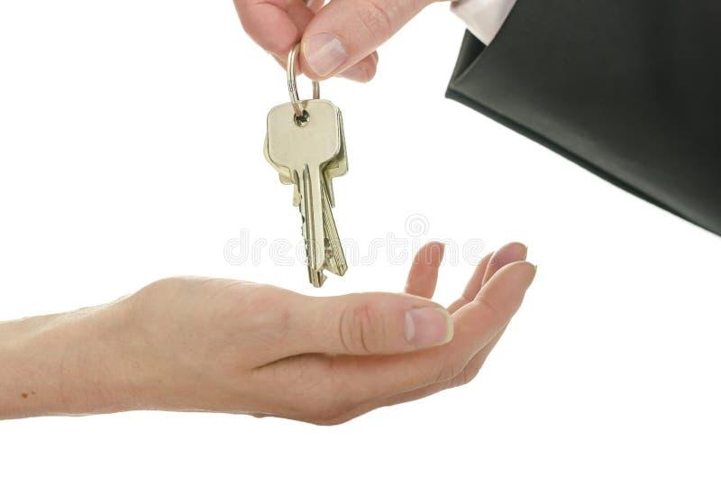 Overdracht van huissleutels stock foto