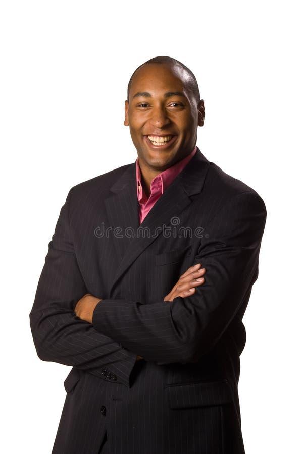 Mens die kostuum met glimlach draagt stock foto