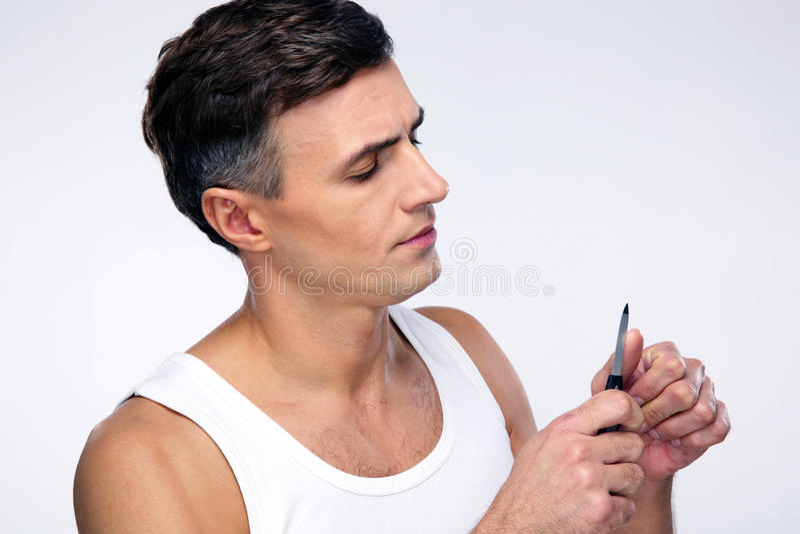 Mens die manicure doen royalty-vrije stock afbeelding