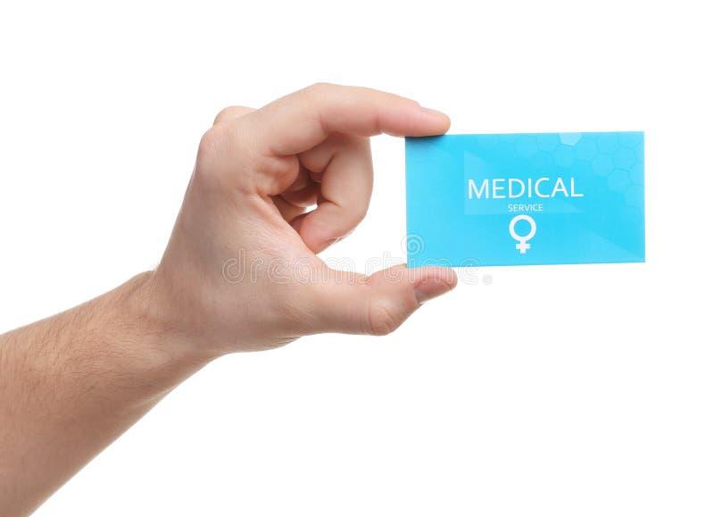Mens die medisch adreskaartje op wit houden, close-up De gezondheidsdienst van vrouwen royalty-vrije stock foto
