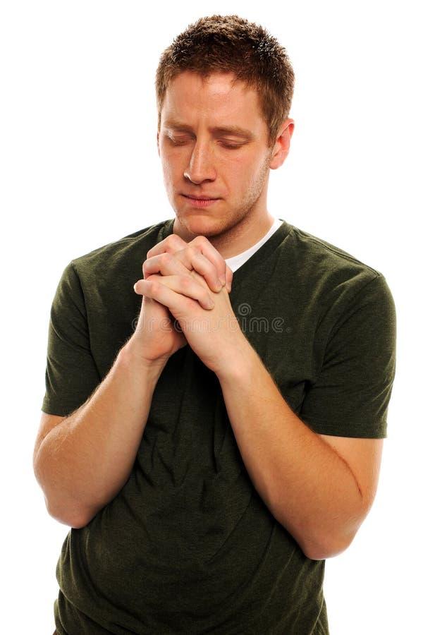 Mens die met Gesloten Handen bidt royalty-vrije stock afbeeldingen