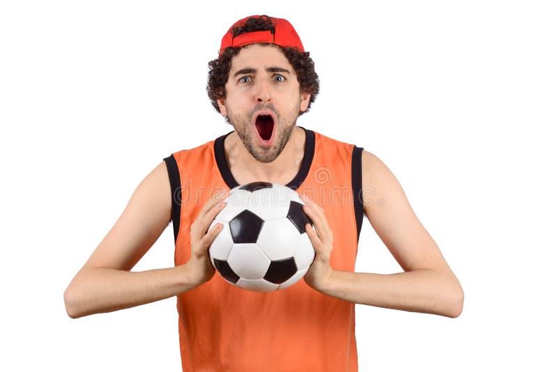 Mens die met voetbalbal gillen royalty-vrije stock afbeeldingen