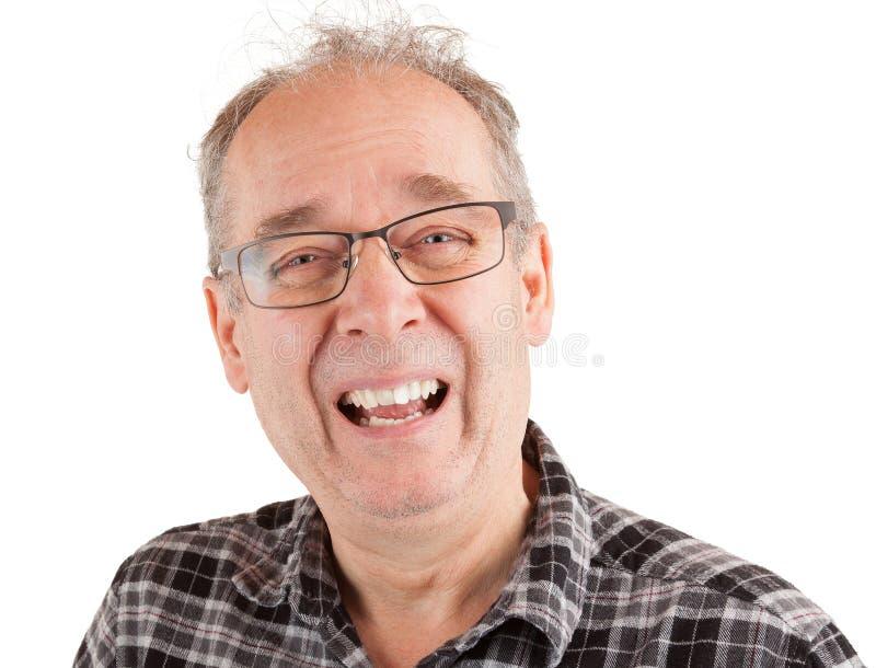 Mens die over iets lachen stock fotografie