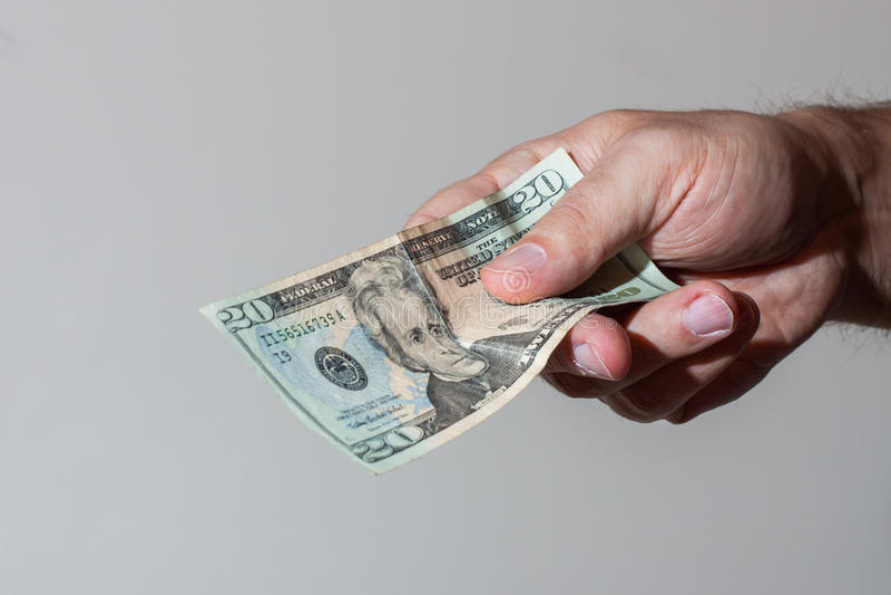 Mens die Twintig Dollarrekening geven royalty-vrije stock fotografie
