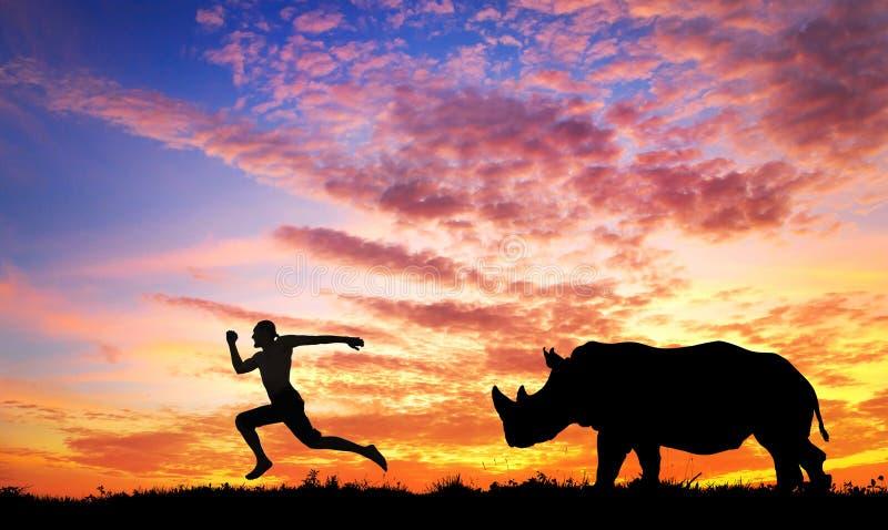 Mens die vanaf Rinoceros lopen royalty-vrije stock fotografie