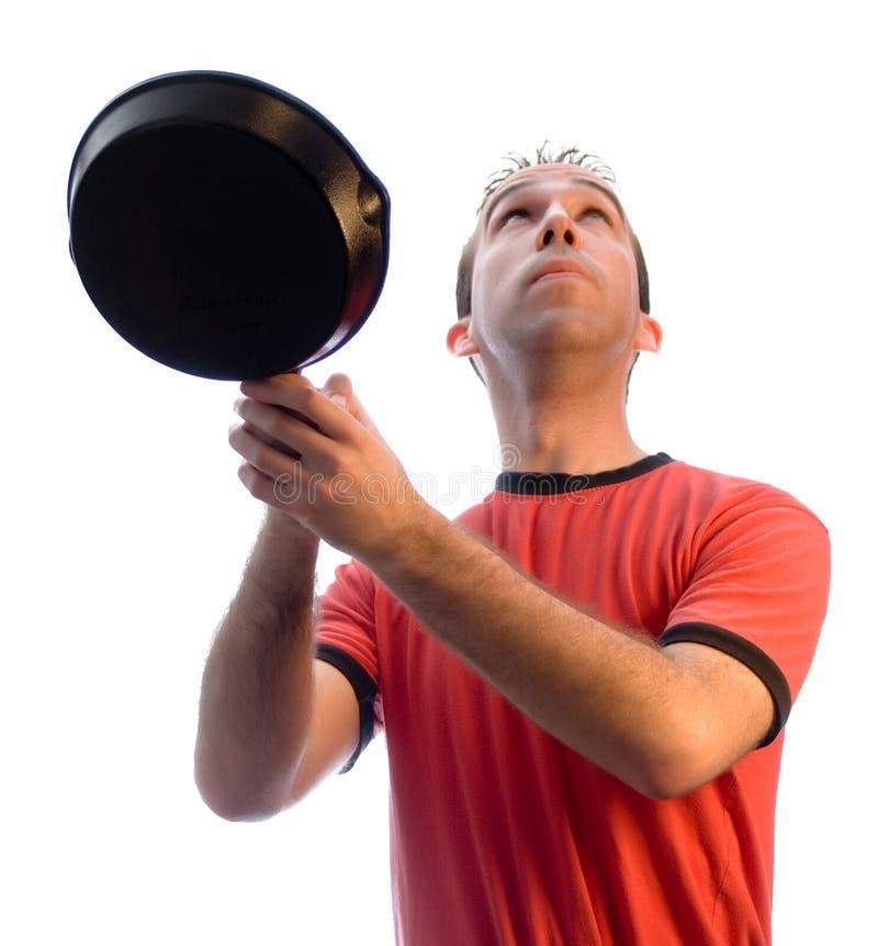 Mens die Voedsel in Pan vangt stock afbeeldingen