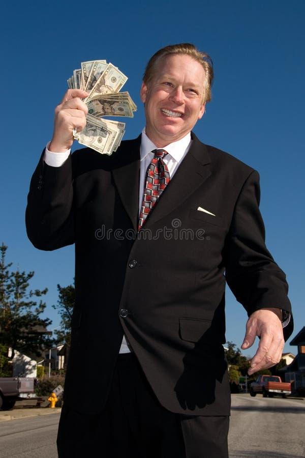 Mens die waait met geld. stock foto's