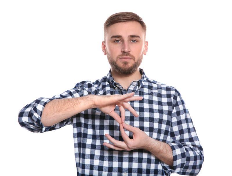 Mens die woordtolk in gebarentaal op wit tonen stock foto