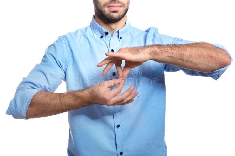 Mens die woordtolk in gebarentaal op witte achtergrond tonen royalty-vrije stock foto's