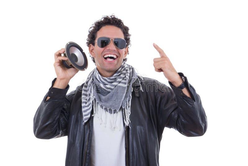 Mens in een leerjasje met spreker stock fotografie