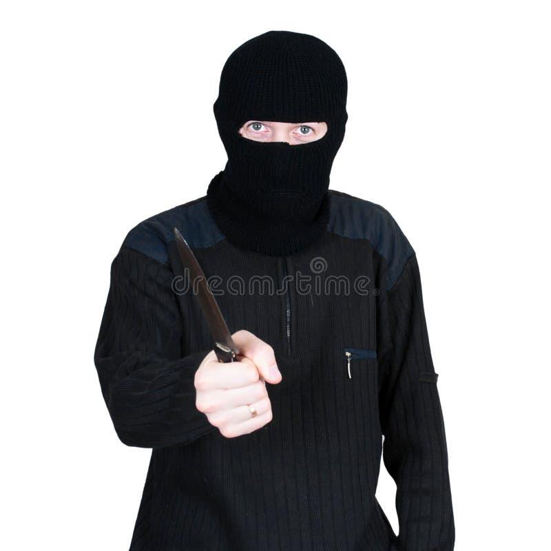 Mens in een masker met een mes op een wit royalty-vrije stock foto's