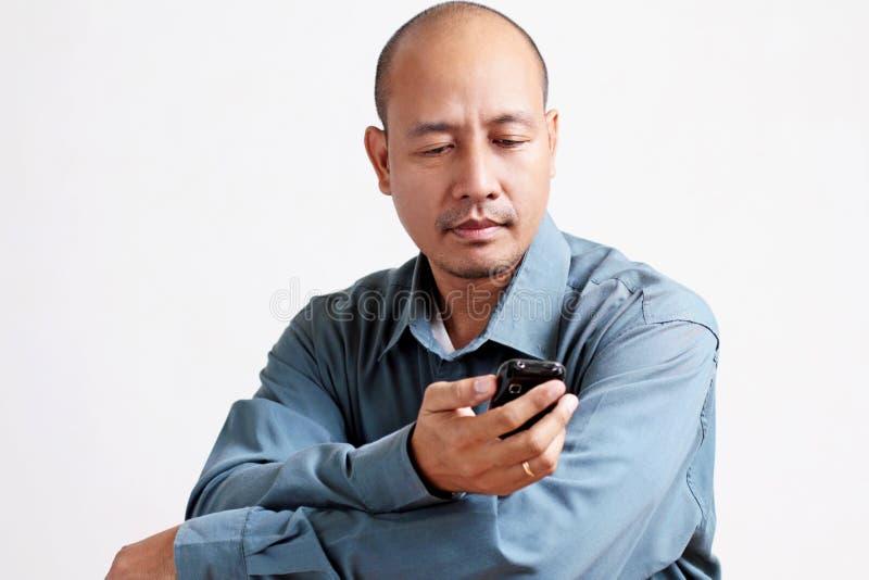 Mens en Cellphone royalty-vrije stock afbeeldingen