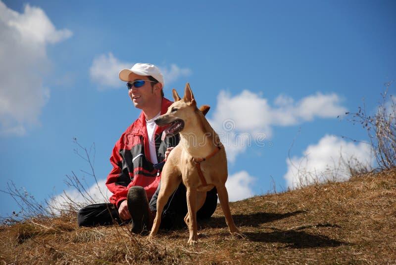 Mens en hond stock fotografie