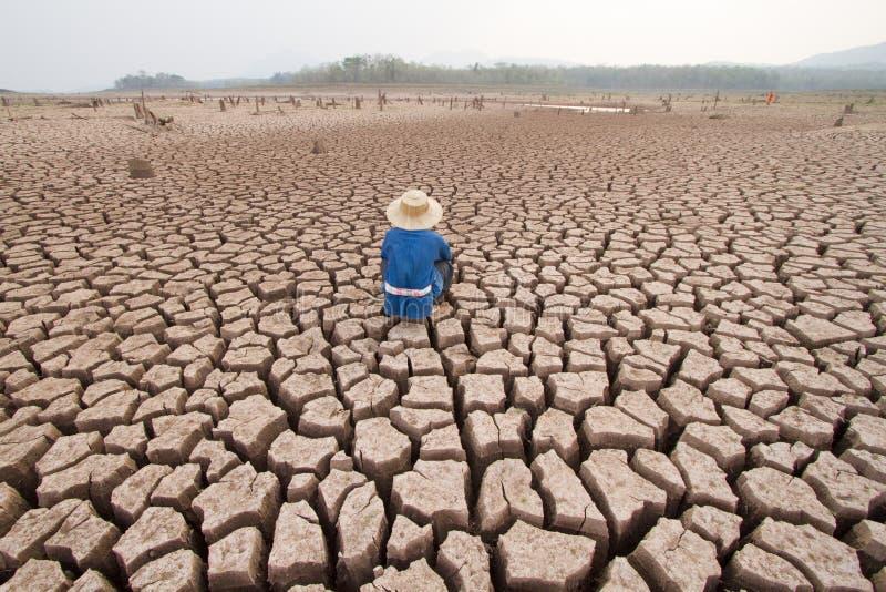 Mens en klimaatverandering stock foto's