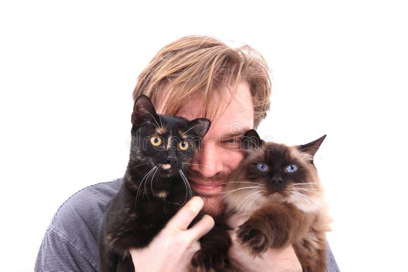 Mens en twee katten royalty-vrije stock afbeelding