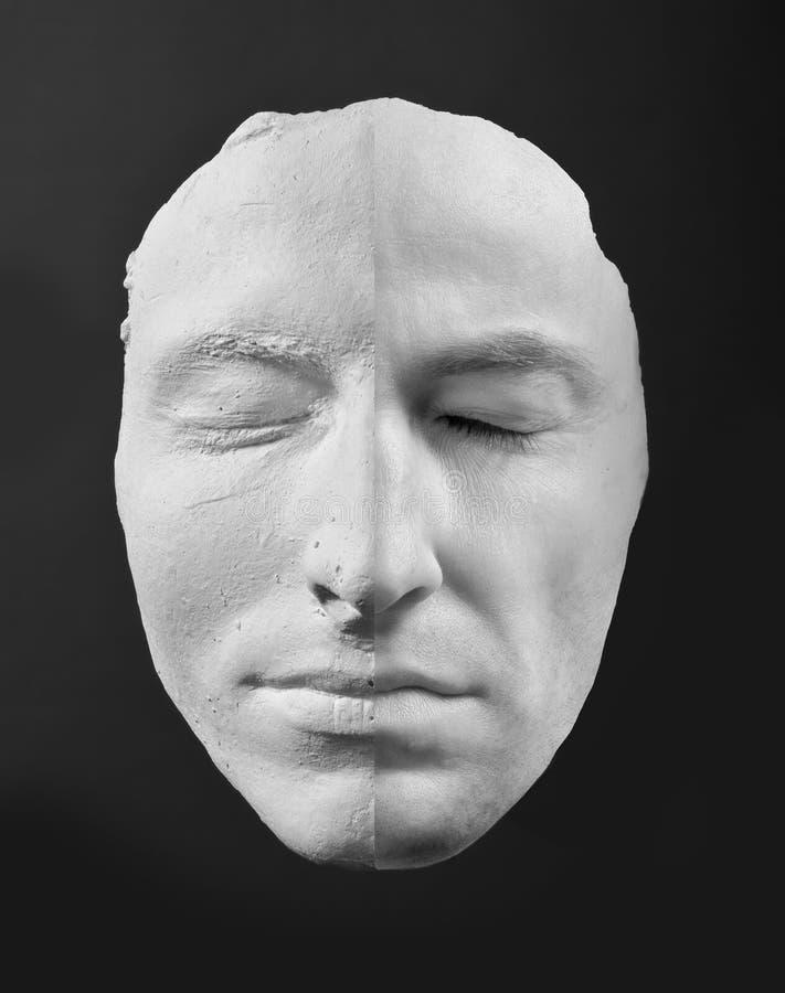 Mens en zijn masker stock afbeeldingen