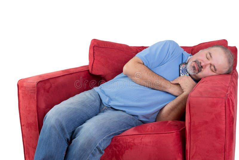Mens gevallen in slaap terwijl het letten van op televisie royalty-vrije stock afbeelding