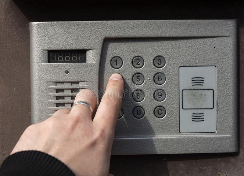 Mens hand presses the button stock photography