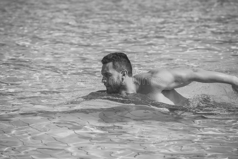 Mens heals body care. Man or young swimmer swimming in pool with blue water royalty free stock photos